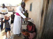 Cote D'Ivoire/Katiola 12/52 Triannual training sessions for the young priests of the diocese: Bishop Ignace Bessi Dogbo blesses the old lady