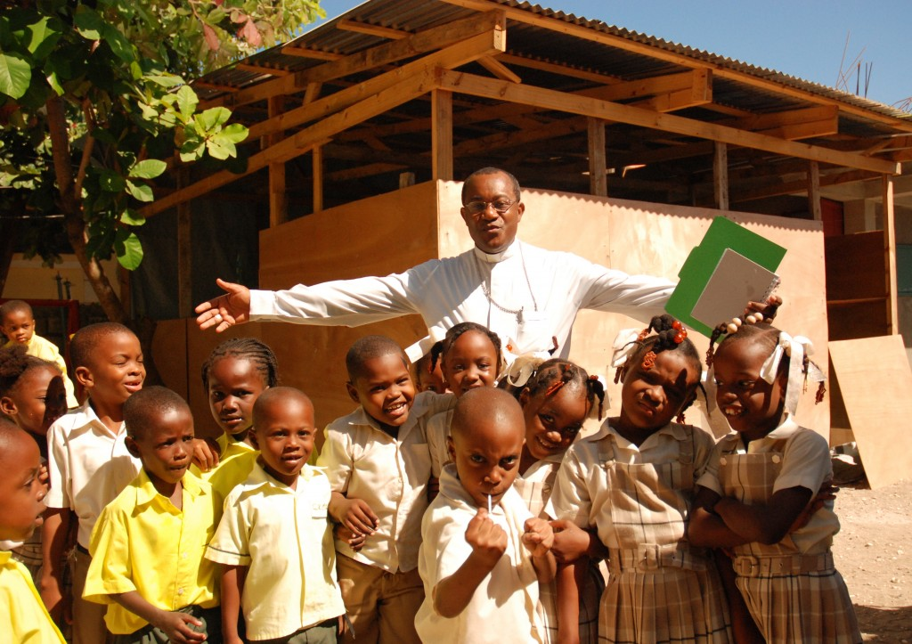 Haiti, dioceseo of Jacmel Nov. 2010  Bishop Launay Saturne  with children at the temporary school Saint Jude in Jacmel. Project trip of Regina Lynch, Rafael D´Aqui and Raphaelle Autric Used as illustration f
