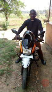 Sierra Leona Fr. Paul Karim with the new motorcycle de frente