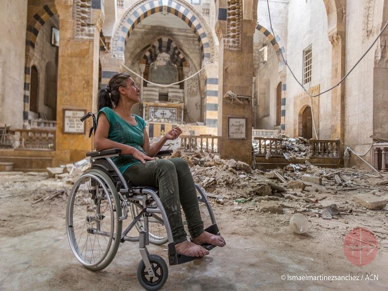 Siria mujer en silla de ruedas web