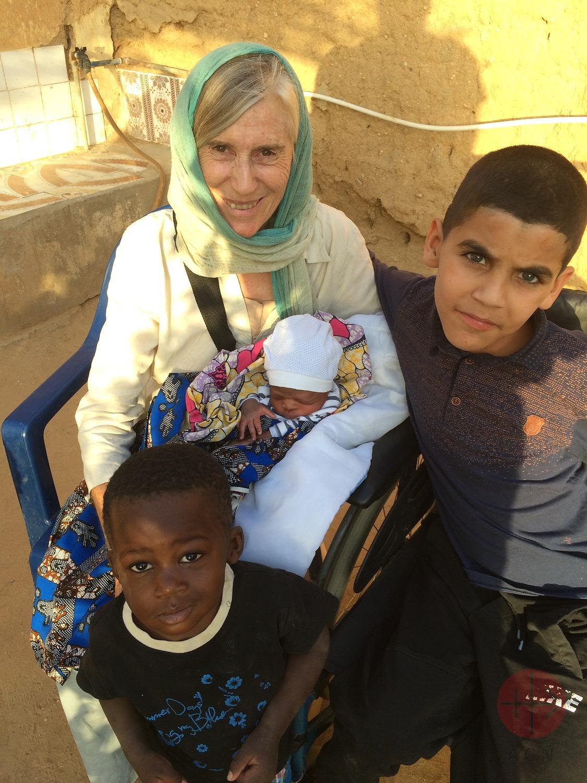 Argelia religiosa con guagua