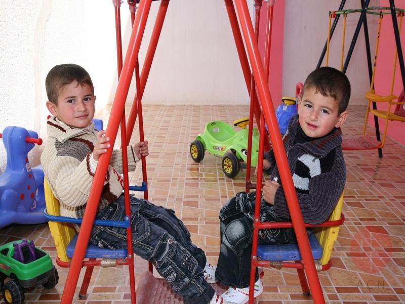 Irak niños jugando web