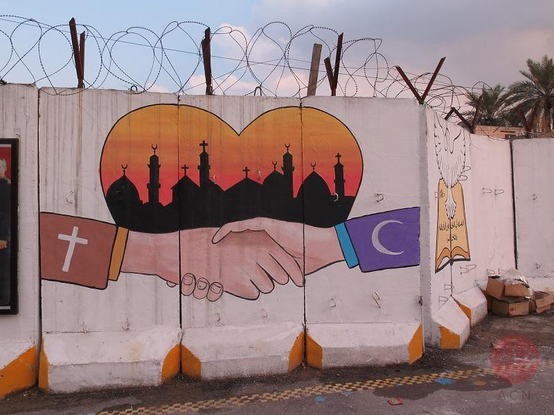 Murales de Catedral de bagdad, cristianismo y musulman se dan la mano web