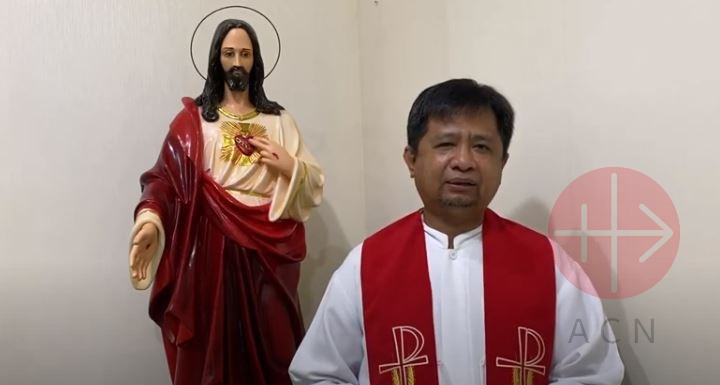 Indonesia Father Wilhelminus Tulak with the statue of Christ