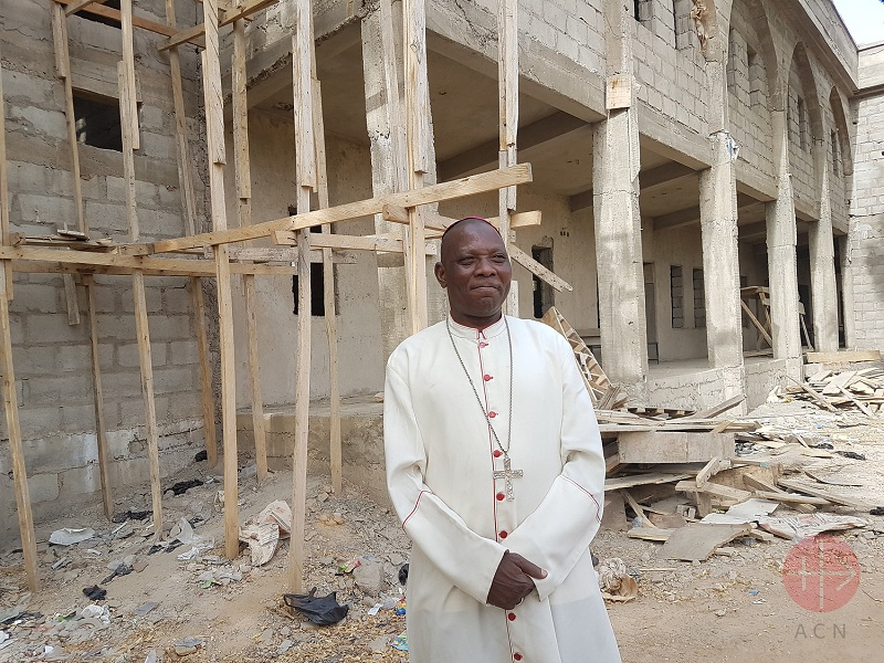 Nigeria Bishop Oliver in front of the Cathedral on construction after Boko Haram Attacks 2011